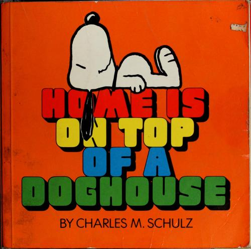 Home is on top of a doghouse by Charles M. Schulz